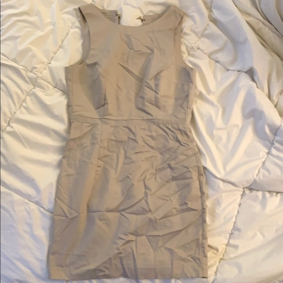 Light gray/tan dress with open back